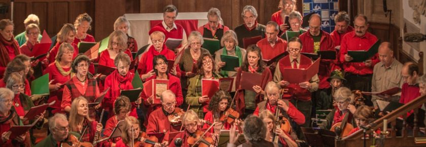 Group performing, dressed in red and green.