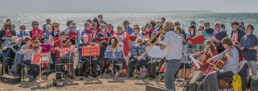 Group of musicians and singers on a beach