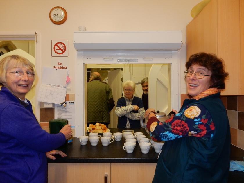 Two ladies serving tea