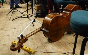 Cello on its side on the floor