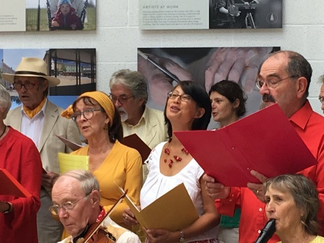 Close up of a few men and women singing